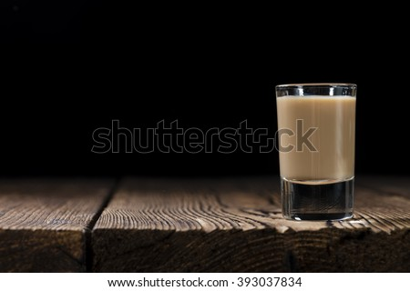 Irish Cream Liqueur (detailed close-up shot) on wooden background