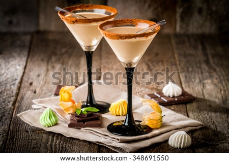 Irish cream liqueur in a glass with   cinnamon on wooden background - stock photo
