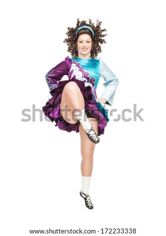 Irish dancer dancing isolated - stock photo