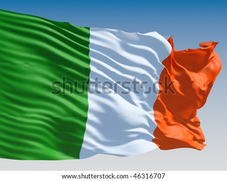 Irish flag flying on clear sky background.