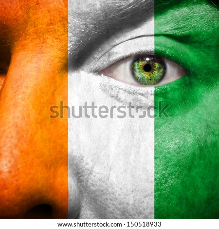 Irish flag painted on mans face to support his country Ireland