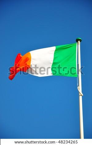 Irish Flag waving in the wind - stock photo