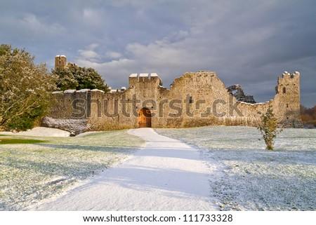 Irish ruins of the castle of Adare in winter scenery - stock photo