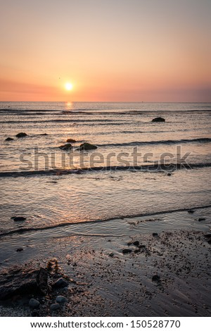 Irish Sea sunrise at Bray County Wicklow Ireland - stock photo