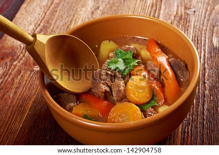Irish stew farm-style  with tender lamb meat, potatoes and vegetables - stock photo