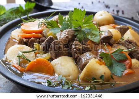 Irish stew, made with lamb, stout, potatoes, carrots and herbs. - stock photo
