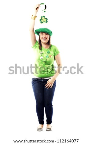Irish young lady dressed for a st patrick's day celebration standing happily