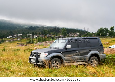 IRKUSKAN, RUSSIA - AUGUST 8, 2008: Motor car Toyota Land Cruiser Prado 90 at the countryside. - stock photo