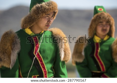 IRKUTSK REGION,RUSSIA-JUNE13: Siberian Yakut men in national costumes during the international ethno-cultural festival Erdyn Games (Erdyn Naadan) in Irkutsk Region near Baikal lake on 13 of June, 2015