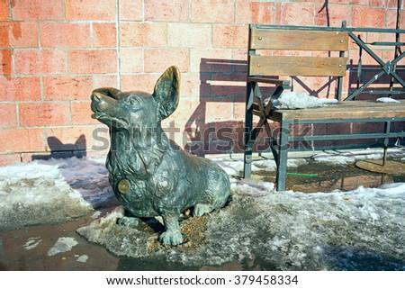 Irkutsk, Russia - February 16, 2016: welsh corgi dog sculpture in Irkutsk, built on July 9, 2004, sculptor Ilya Stawski. - stock photo