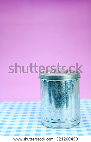 Iron Bin on pink background. - stock photo