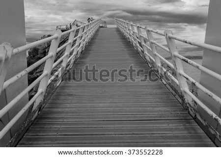 Iron bridge with wooden floors and rust by the sea, in Aviles, Spain