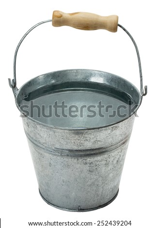 iron bucket with water isolated on the white background - stock photo