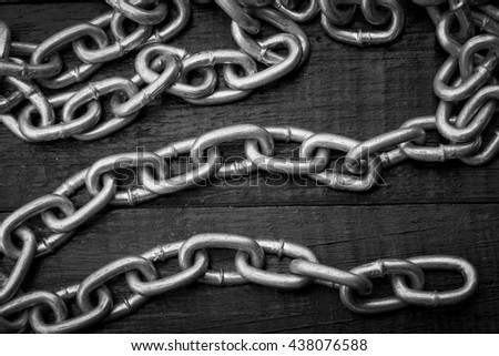 iron chain on red wooden background with shadow edge in white tone