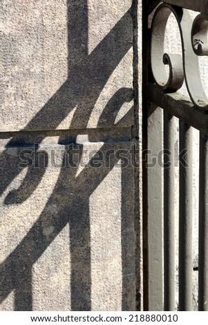 iron - courtyard with shadow - stock photo
