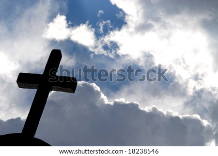 iron cross against blue shining sky