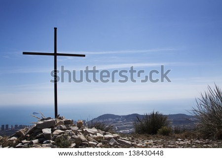 Iron cross over the see in Benidorm - stock photo