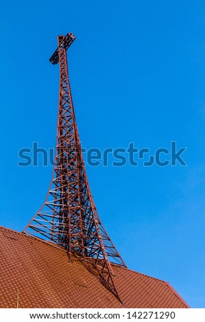 iron crosses above the roof's church in the blue sky - stock photo