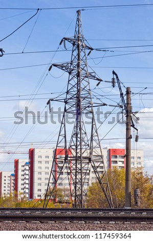 Iron electric pole on the background of the city. - stock photo