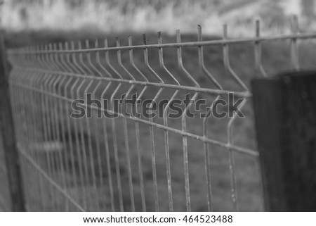Iron fence in black and white