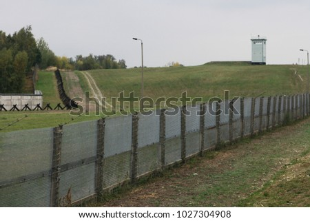 Iron fense  at inner german wall with barb wires