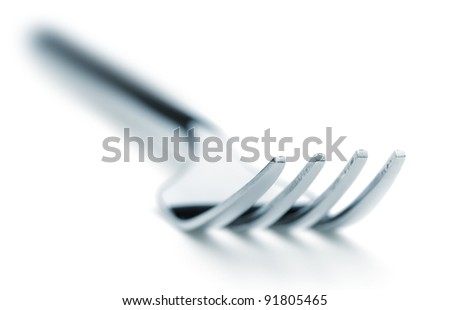Iron fork selective focus. It is isolated on a white background