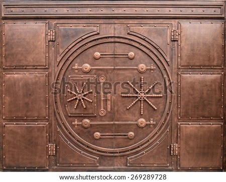 Iron gate in the form of door in safe - stock photo