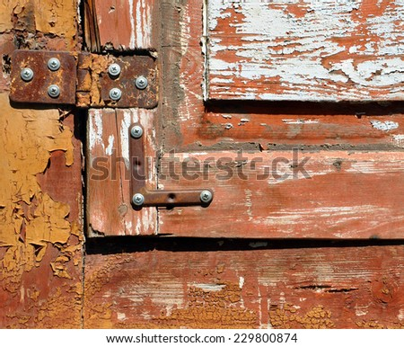 iron hinges of the old painted window - stock photo