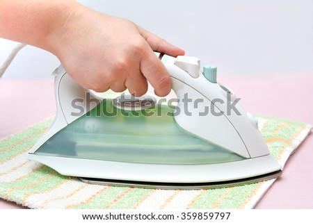 Iron in the hand. Ironing