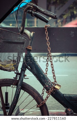 iron lock on a old bicycle, process color - stock photo
