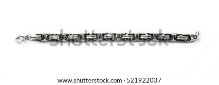 Iron men's bracelet with black inserts is isolated on a white background