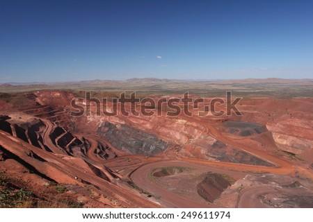 Iron ore mine pit Pilbara region Western Australia - stock photo