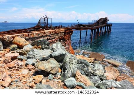 Iron ore on Island of Elba coast. Old abandoned mine nearby Rio Marina City. Toscana, Italy. - stock photo
