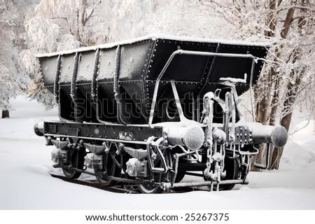 iron ore wagon in winter cold - stock photo