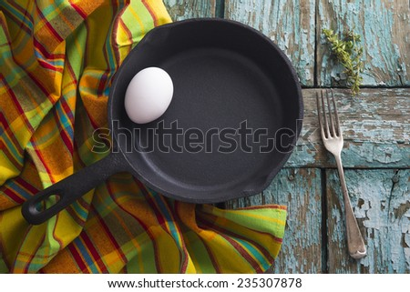 iron pan with egg and towel - stock photo