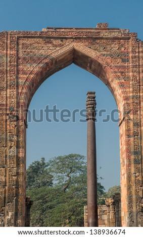Iron pillar at Qutub Minar, Delhi, India - stock photo