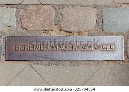 Iron plaque of the Berliner wall near checkpoint Charlie - stock photo