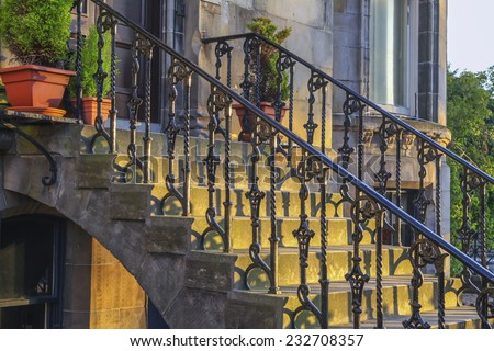 Iron railing and doorsteps, classic handrail and side panel design at house entrance in sunset