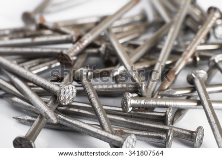 Iron rusty nails on a white background  - stock photo