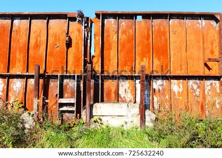 Iron rusty wall against a bright blue sky in the harbor area of the midland channel in Hanover, Lower Saxony, Germany