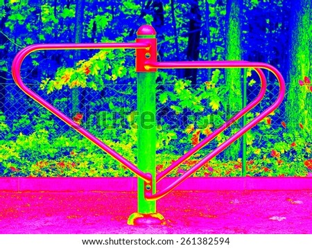Iron seesaw in construction on kids playground. Infrared scan in amazing thermography colors. - stock photo