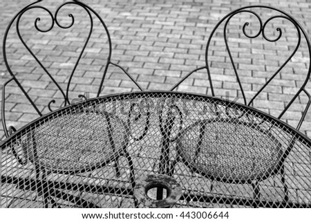 Iron table and chairs on outdoors - stock photo