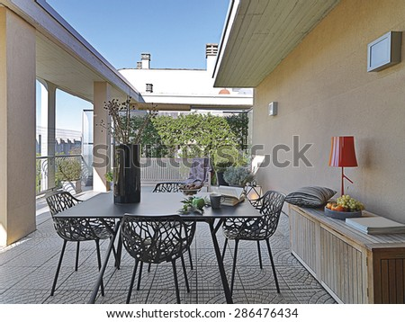 iron table and chairs on the modern terrace - stock photo