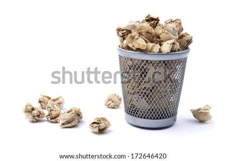 Iron trash bin full of paper isolated on white background