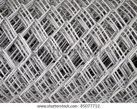 Iron wire fence texture - stock photo