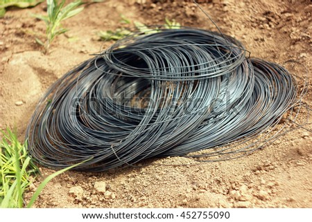 iron wire on the ground - stock photo
