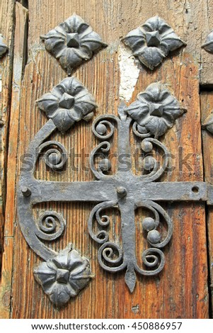 iron work on a traditional wooden door in Tarazona (Zaragoza) Spain