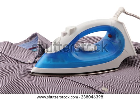 Ironing a shirt with a steam iron