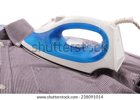 Ironing a shirt with a steam iron - stock photo
