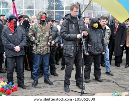 """IRPIN, UKRAINE - CIRCA FEBRUARY 2014: One of the leaders of radical party """"Right sector"""" with unknown fighters take part in a meeting tribute to Ukrainian revolution circa Feb 2014 in Irpin, Ukraine - stock photo"""